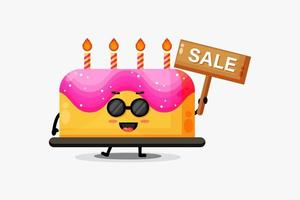 niedliches Geburtstagskuchenmaskottchen mit dem Verkaufszeichen vektor