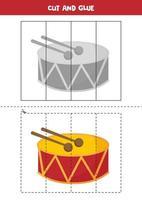 Spiel zum Schneiden und Kleben für Kinder. Cartoon-Trommel. vektor