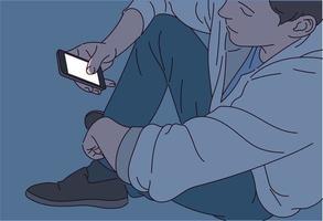 Ein Mann schaut im Dunkeln auf sein Handy und das Licht auf dem Bildschirm scheint. vektor