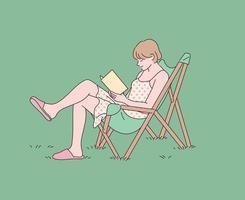 Ein Mädchen liest ein Buch mit einem Stuhl auf dem Rasen. vektor