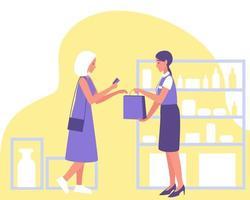 en kund betalar med kreditkort i en kosmetisk butik