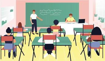 i klassrummet svarar en av eleverna på tavlan