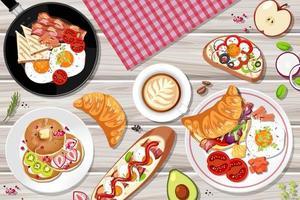 Draufsicht auf das Frühstück auf dem Tisch vektor