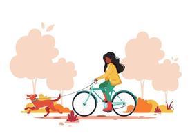 svart kvinna ridning cykel med hund i höst park. hälsosam livsstil, utomhusaktivitetskoncept. vektor illustration.