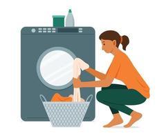 Frau wäscht die Kleidung mit Waschmaschine. vektor