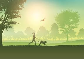 Kvinna joggar med hund på landsbygden