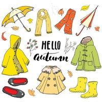 Herbstkleidung Kleidungsset. handgezeichnete Kritzeleien und Beschriftungsvektorillustration. vektor