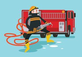 Brandman i aktion som håller slangen