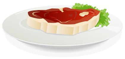 Styck av rått kött på en maträtt med sallad