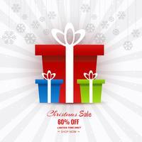 Schöne Karte der frohen Weihnachten mit Geschenkbox Weihnachtsverkauf zurück vektor
