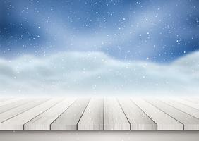 Träbordet ser ut mot ett snöigt landskap