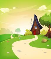Feenhaftes Haus innerhalb der Frühlingslandschaft
