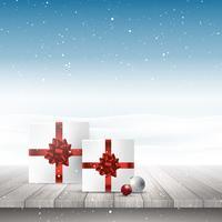 Weihnachtsgeschenke auf einem Holztisch, der heraus zu einem schneebedeckten landsca schaut