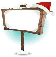 Weihnachtsmann-Hut auf hölzernem Zeichen