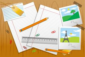 Foto mit stationärem und Papier auf dem Tisch