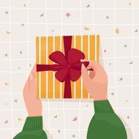 Hände halten und öffnen ein Geschenk. süße Vektorgrafik im flachen Cartoon-Stil für Banner, Poster, Neujahr, Frohe Weihnachten, Valentinstag oder Glückwunschkarte zum Geburtstag vektor