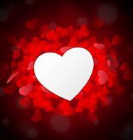 Valentinsgrußherz als Papier vor roten kleinen Herzen