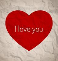 Rött hjärta på vintagepapper vektor