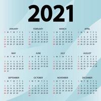 Kalender 2021 Jahr - Vektor-Illustration. die woche beginnt sonntag. Jahreskalender 2021 Vorlage. Wandkalender mit abstraktem blauem Hintergrund. Sonntag in roten Farben. Vektor