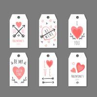 Gulliga Alla hjärtans etiketter med hjärtan, pilar och meddelanden. vektor