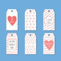 Die Etiketten-Sammlung des netten Valentinsgrußes mit Herzen und Pfeilen.