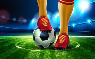 Fotboll på fotbollsarenan med en del av fotbollsspelarens fot.
