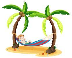 Ein Junge, der unter dem Kokosnussbaum kühlt