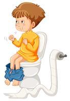 Liten pojke på toaletten
