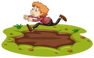 Ein Mann springt über Schlamm vektor