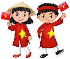 Vietnamesisk tjej och pojke i röd kostym