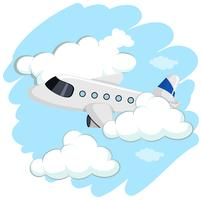 Flygplan som flyger högt upp i himmelen