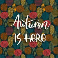 Lettering design med abstrakt höst bakgrund med löv.