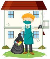 En man som rengör gården