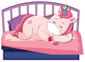 Ein Einhorn, das auf dem Bett schläft