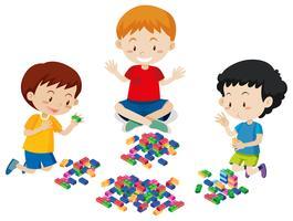 Jungen, die Lego auf weißem Hintergrund spielen vektor