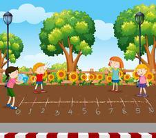 Studenten, die Würfelspiel am Spielplatz spielen