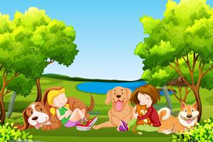 Människor och husdjur på parken