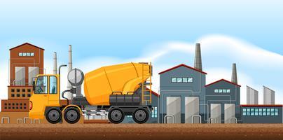 Fabriksplats med cementblandare
