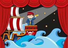 Pojke spelar pirat på scenen