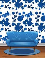 Blå soffa i rum med blå stänk tapeter