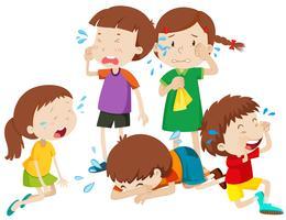 Fem barn gråter med tårar