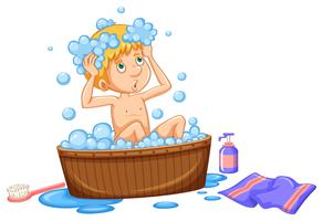 Junge, der Bad in der braunen Wanne nimmt