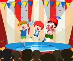 Tre cirkus barn som utför
