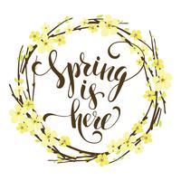 Sping är här. Lettering design med blommande grenar.