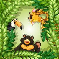 Vilda djur på grön lämnarram vektor