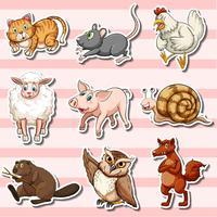 Aufkleber mit niedlichen Tieren auf rosa Hintergrund vektor