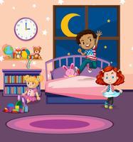Barn hoppar på sängen