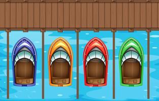 Vier Boote parken am Pier vektor