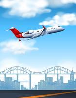 Flygplan som flyger över staden på dagtid