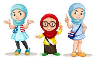 Tre muslimska tjejer med gott ansikte